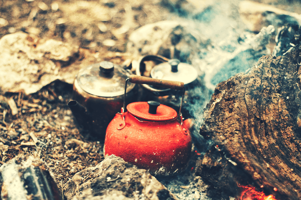 kettles sitting on a bed of coals