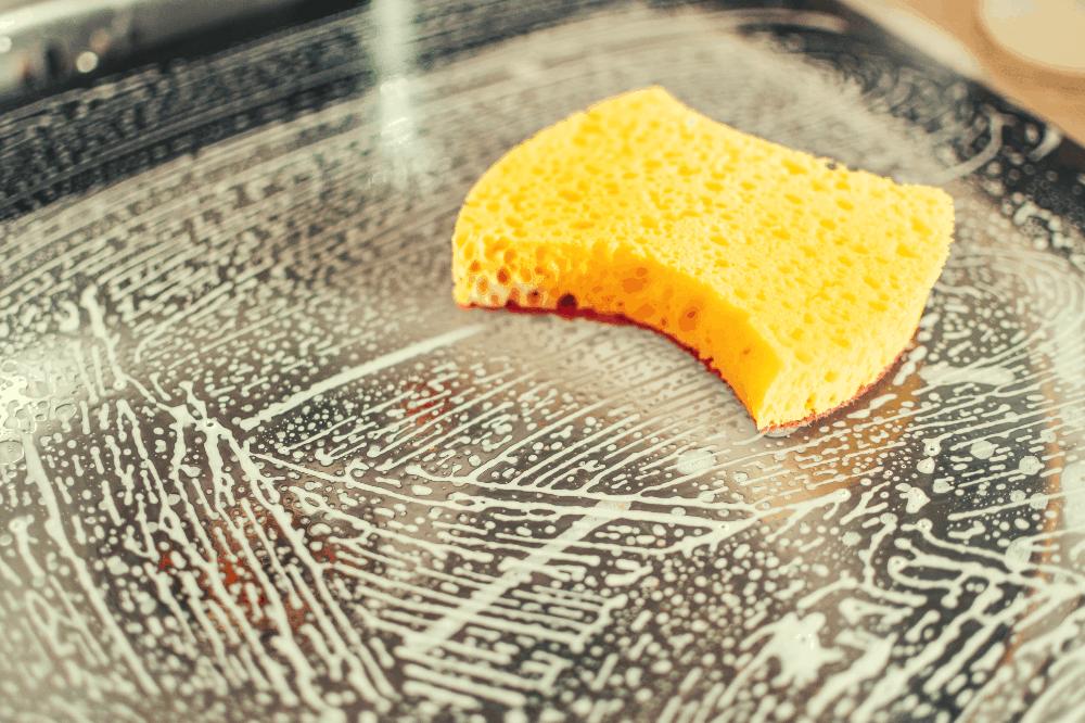 soapy sponge on a car