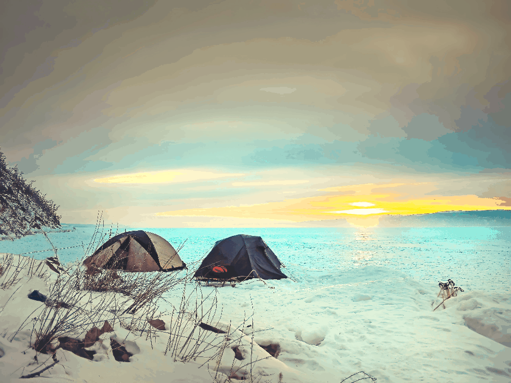 two tents pitched on the snow