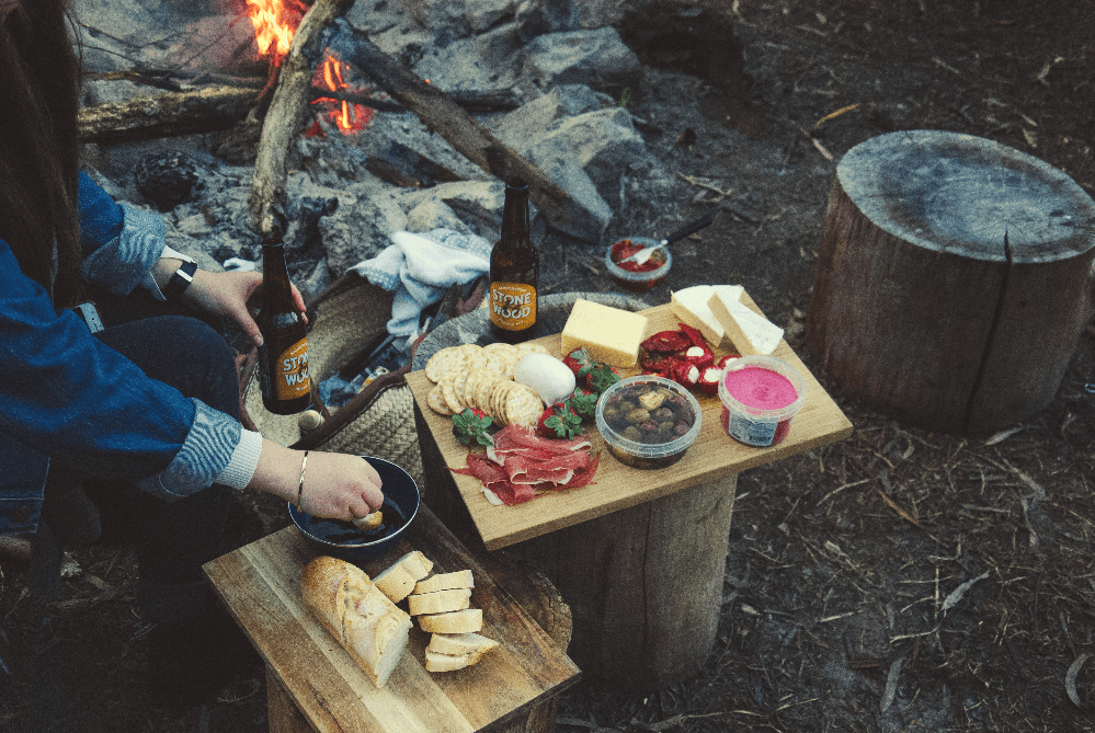 person preparing food over an open fire