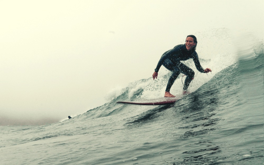 person standing on a surf board on water