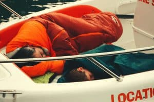 two people sleeping in a mummy sleeping bag on a boat