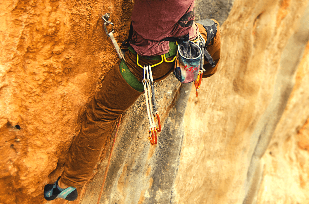 quickdraws hanging off a harness