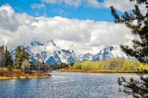 grand teton mountains next to a lake in wyoming