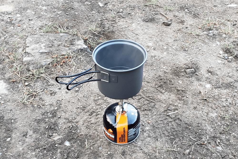 single propane burner camping stove on the ground