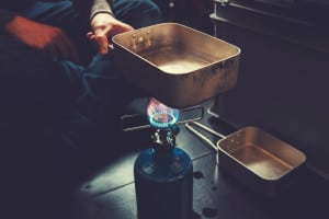 a pot of water being held over a single propane burner