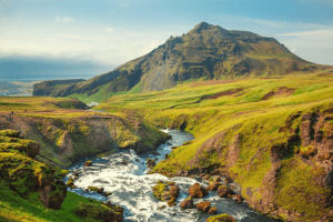 iceland river flowing to the ocean